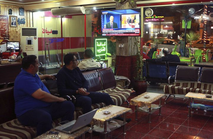 Men watch the TV news in Baghdad, Iraq, on March 6, 2017.