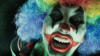 A creepy clown close up.