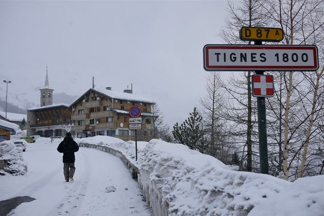 A road sign is seen on the side of a mountain road after a snow fall in Tignes on January 15 this