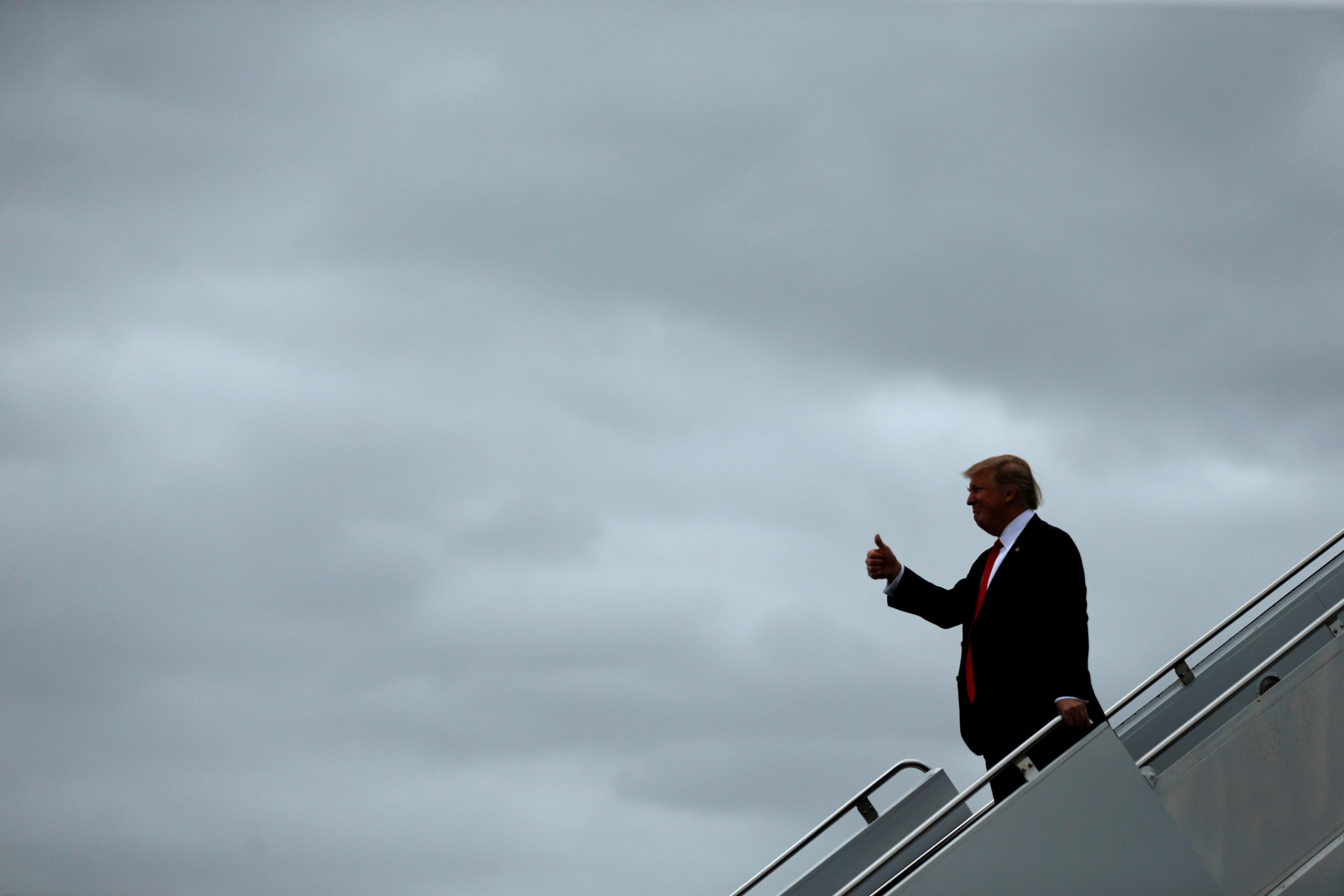 U.S. President Donald Trump arrives aboard Air Force One at Palm Beach International Airport in West Palm Beach, Florida, U.S