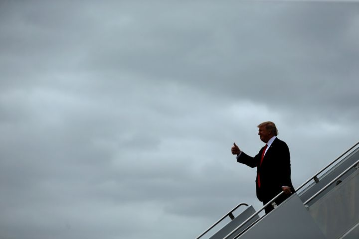 U.S. President Donald Trump arrives aboard Air Force One at Palm Beach International Airport in West Palm Beach, Florida, U.S