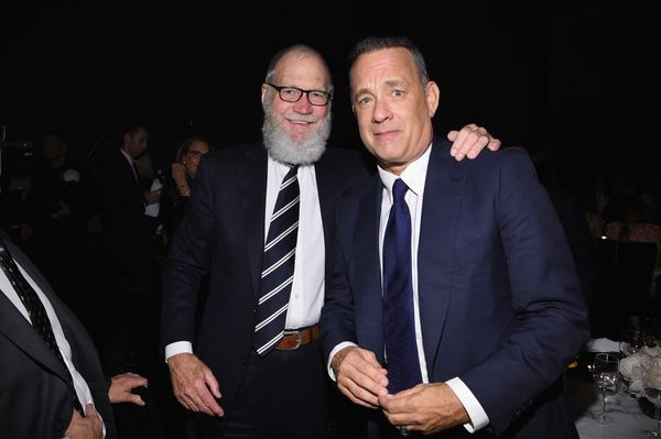 """Impressing the smile off of Tom Hanks at """"A Tribute To Tom Hanks"""" at the Museum of Modern Art in New York City in November 20"""