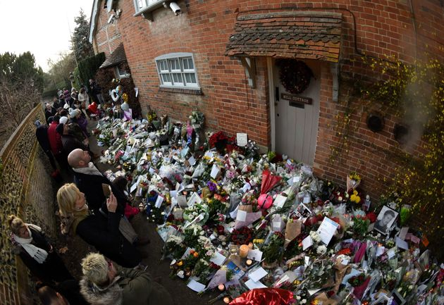Flowers, messages and candles have been left in tribute outside George Michael's