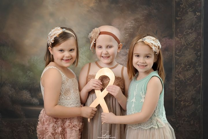 This year, the girls held a gold ribbon for childhood cancer awareness.