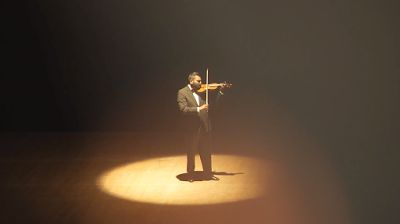 Amit (Albert Thakur) performs a violin solo during his recital in a scene from <strong><em>Crescendo</em></strong>