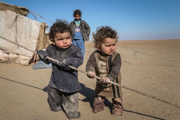 Syrian children who fled Raqqa city stand near their tent in Ras al-Ain province, Syria January 22. The...
