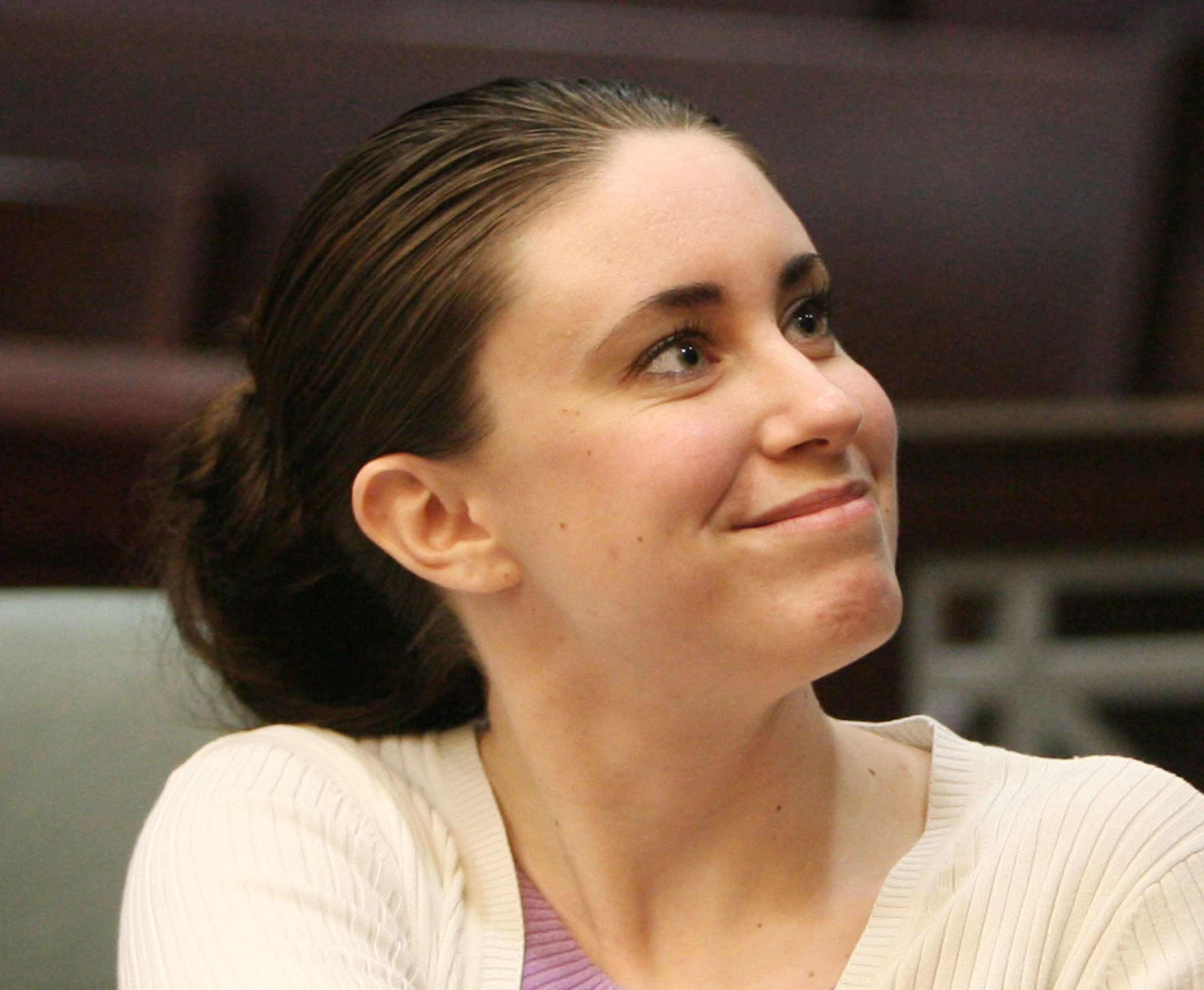 Casey Anthony smiles as she greets her defense team during a court hearing at the Orange County Courthouse on Thursday, March 12, 2009, in Orlando, Florida. Anthony was accused of killing her daughter, two-year-old Caylee Marie Anthony last summer.  (Photo by Red Huber/Orlando Sentinel/MCT via Getty Images)