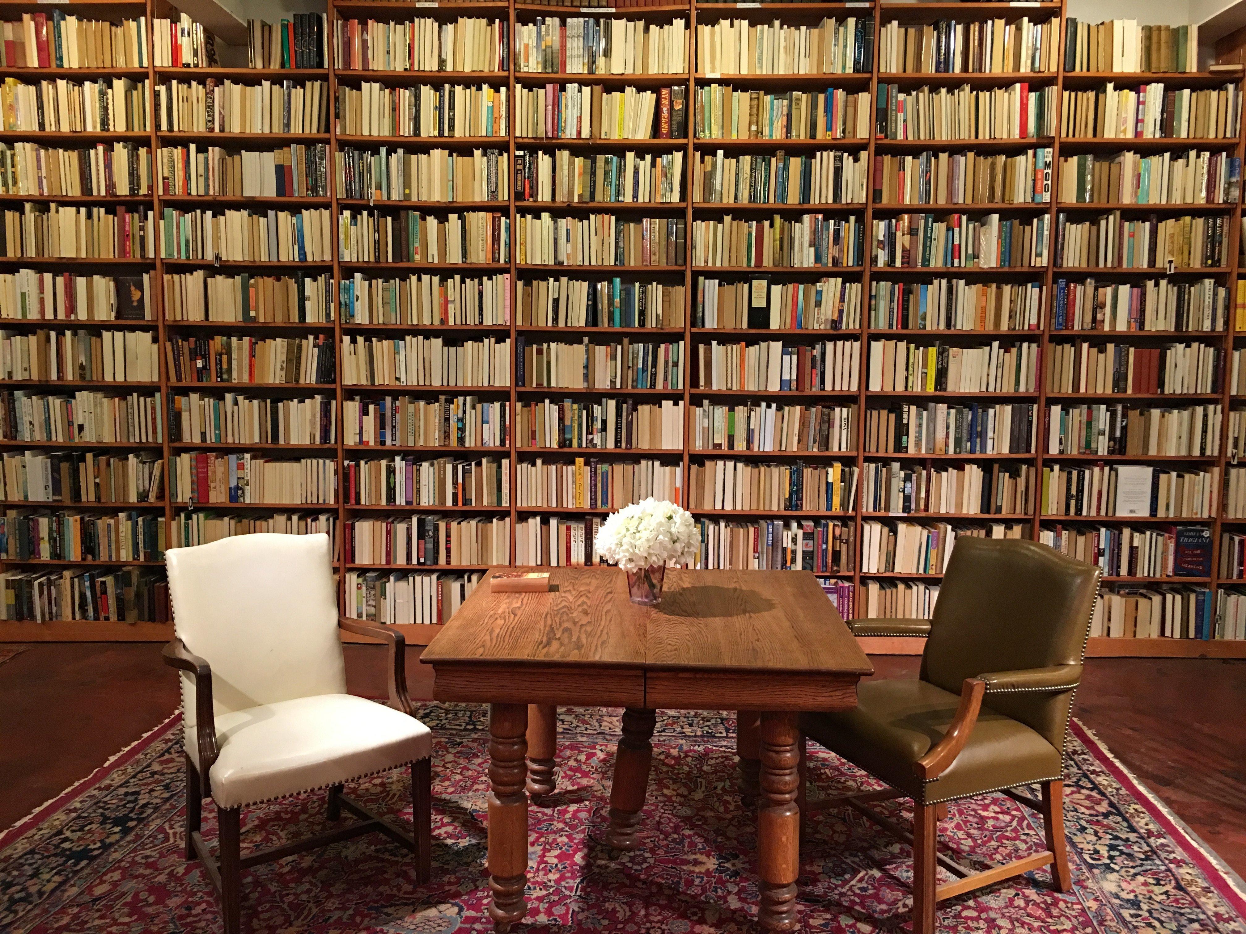 Shelves full of backward spines emphasize the gender imbalance in