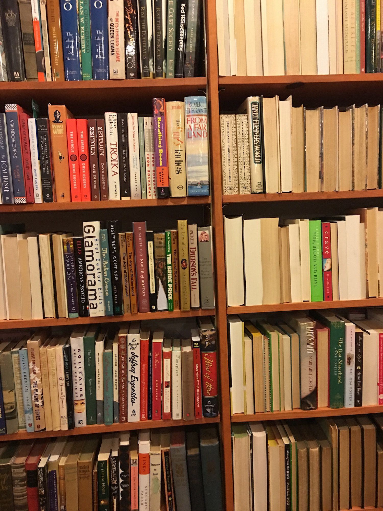 We spot Jeffrey Eugenides and Bret Easton Ellis on this seemingly half-complete shelf.