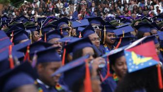 WASHINGTON, DC - MAY 07:  Ciearra Jefferson (C) of Detroit, Michigan, a member of the class of 2016, reacts as U.S. President Barack Obama mentions about her in his address for the 2016 commencement ceremony at Howard University May 7, 2016 in Washington, DC. President Obama is the sixth sitting U.S. president to deliver the commencement speech at Howard University.  (Photo by Alex Wong/Getty Images)