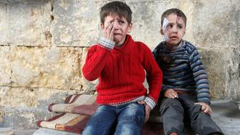 Injured boys react at a field hospital after airstrikes on the rebel held areas of Aleppo, Syria November 18, 2016. REUTERS/Abdalrhman Ismail     TPX IMAGES OF THE DAY       ATTENTION EDITORS - VISUAL COVERAGE OF SCENES OF INJURY OR DEATH