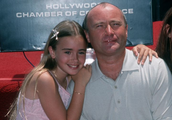 Lily Collins and Phil Collins in 1999.