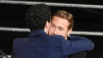 HOLLYWOOD, CA - FEBRUARY 26:  Director Damien Chazelle (L) embraces actor Ryan Gosling after winning Best Director for 'La La Land' during the 89th Annual Academy Awards at Hollywood & Highland Center on February 26, 2017 in Hollywood, California.  (Photo by Kevin Winter/Getty Images)