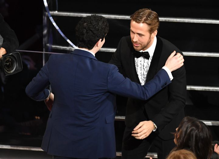 "Director Damien Chazelle embraces actor Ryan Gosling after winning Best Director for ""La La Land"" during the 89th Oscars on F"