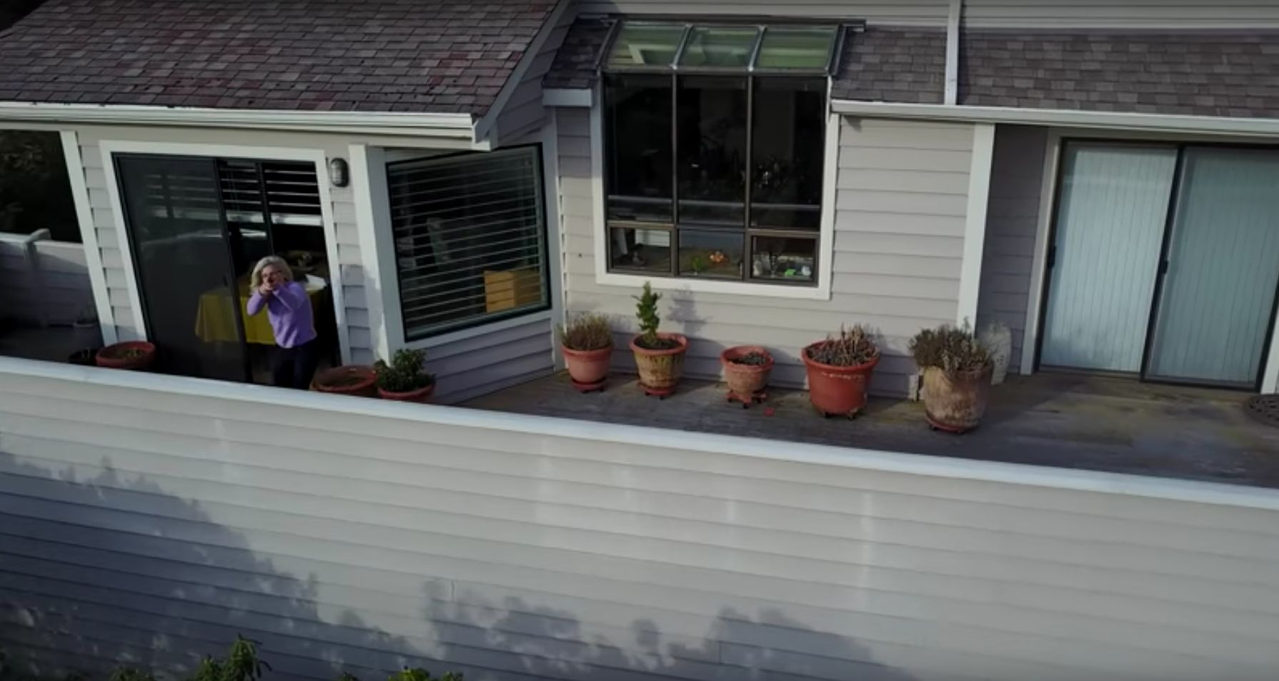 Video taken by a drone last week appears to show a woman attempting to shoot it down after it started filming her home.