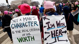 WASHINGTON, D.C. - JANUARY 21: One day after Donald Trump's presidential inauguration, an estimated 600,000 anti-Trump protestors fill the streets during the Women's March on January 21, 2017 held in the area surrounding the Washington Mall. Grandmothers, mothers, and daughters all attended to protest both Donald Trump's past comments and his political positions on health care and abortion. (Photo by Andrew Lichtenstein/Corbis via Getty Images)