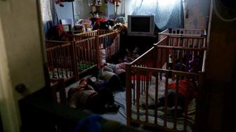 Inside one of the unlicensed overcrowded daycare centers that are often the only childcare option for asylum seeker mothers working in Tel Aviv