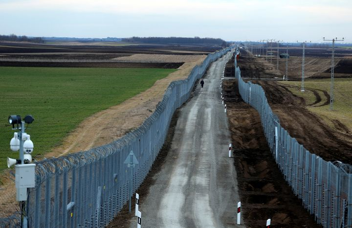 A Hungarian policeman patrols the Hungary-Serbia border, which was recently fortified by a second fence, near the village of