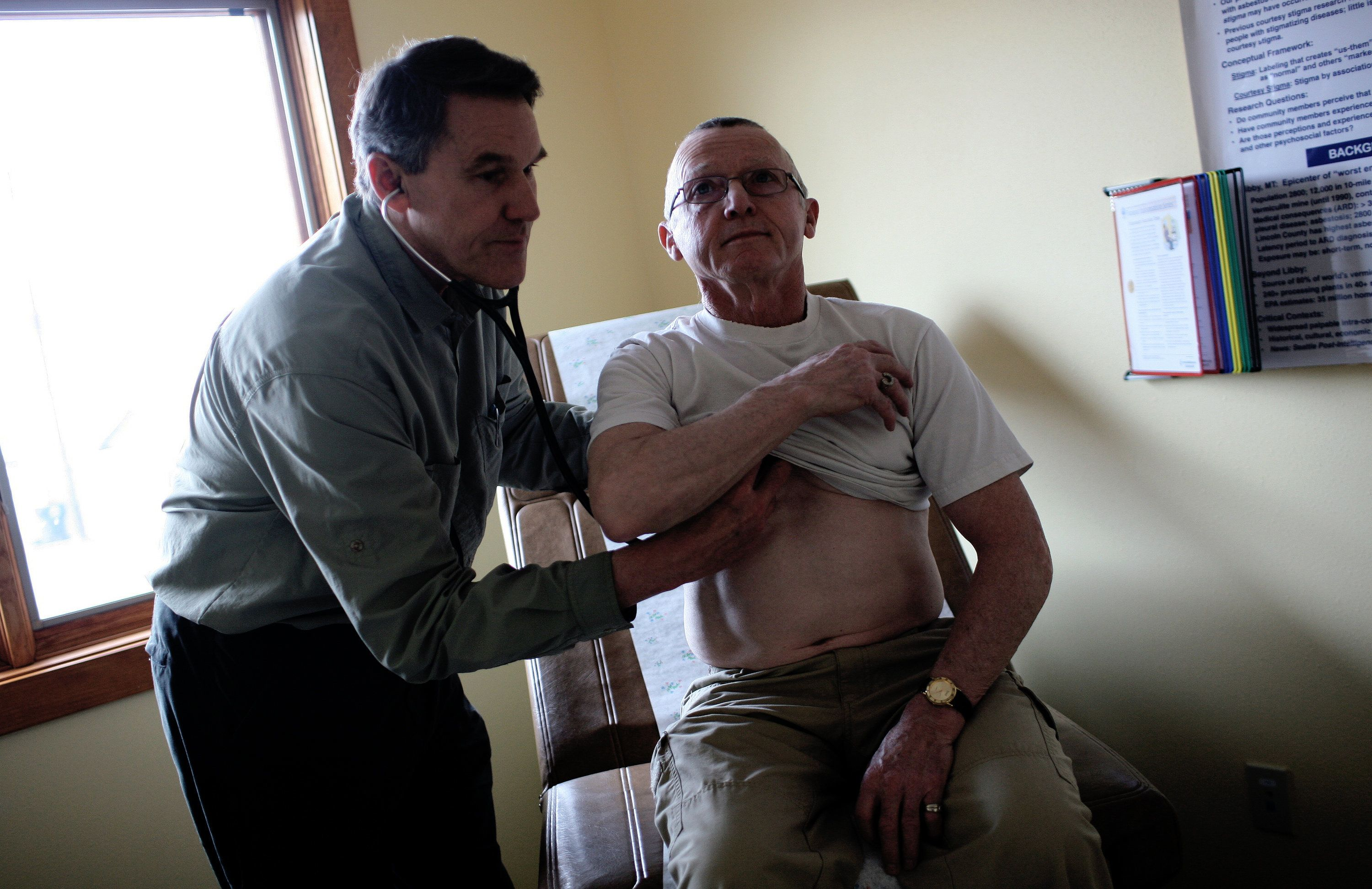 Dr. Brad Black, the CEO of Libby's Center for Asbestos Related Disease, checks one of his patients, Thomas Creighton.