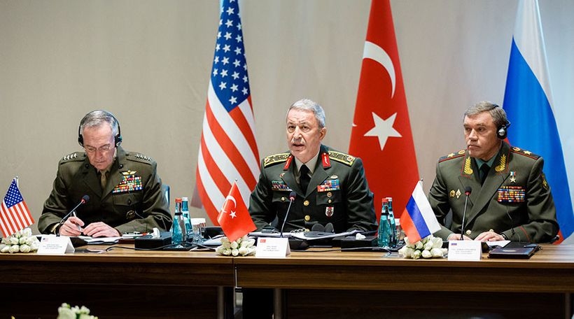 Turkish Chief of General Staff Gen. Hulusi Akar (C) speaks along with his American and Russian counterparts at a meeting in A