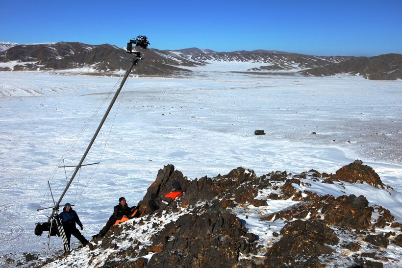 Film crew on Mongolian cliff: Ben Crossley, Camera Assistant; Simon Niblett, DP; & Otto Bell, Director