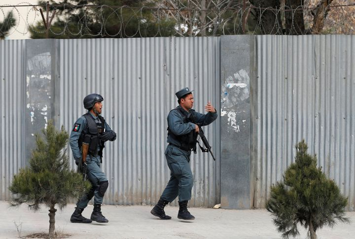 Afghan police arrive at the site of an attack on a military hospital in Kabul on Wednesday.
