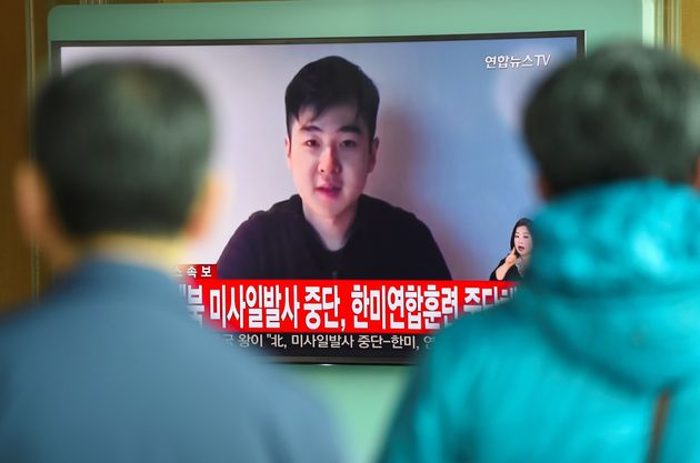 South Koreans watch a television news showing a video footage of a man who claims he is Kim