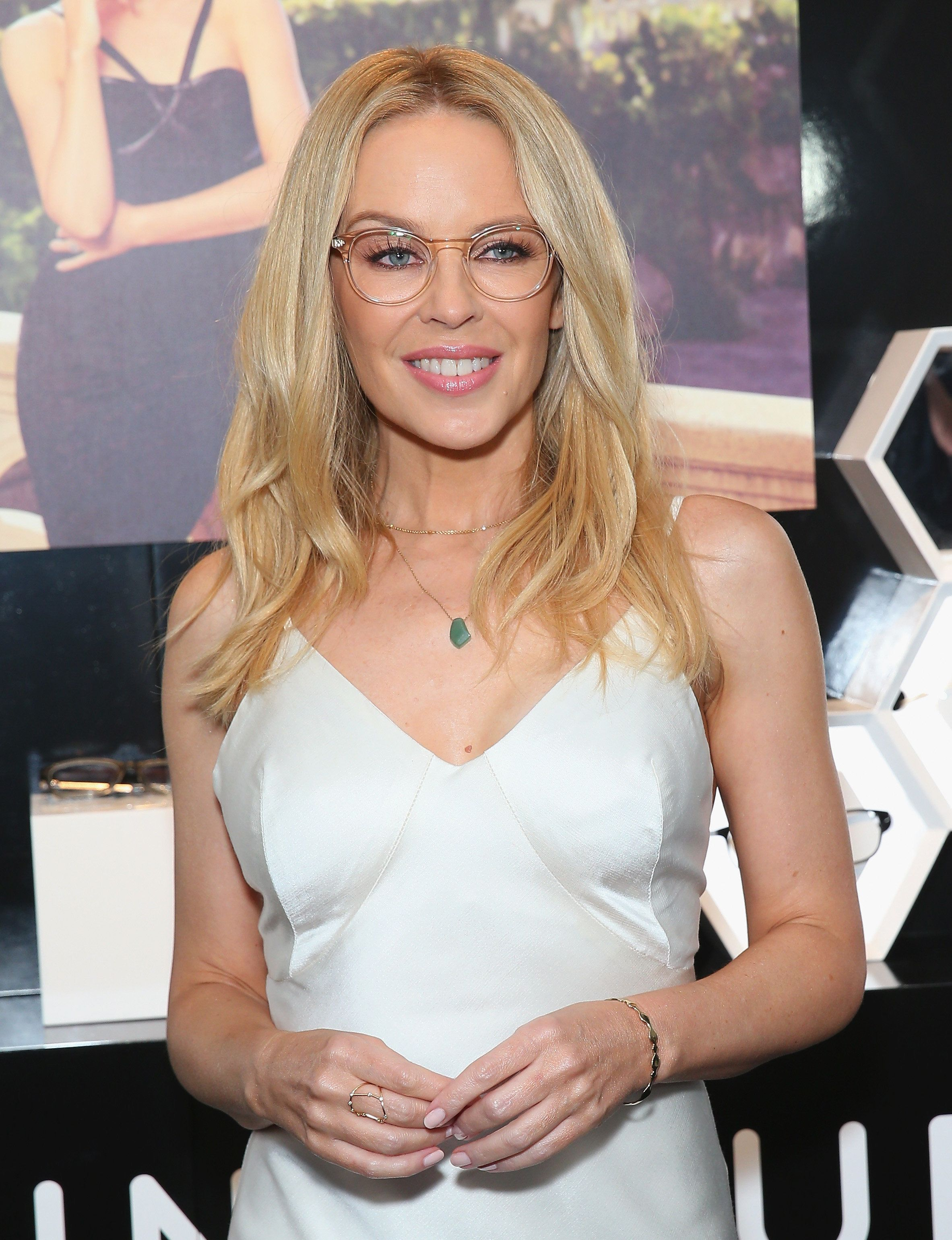 Kylie Minogue poses at the launch of her eyewear collection for Specsavers in