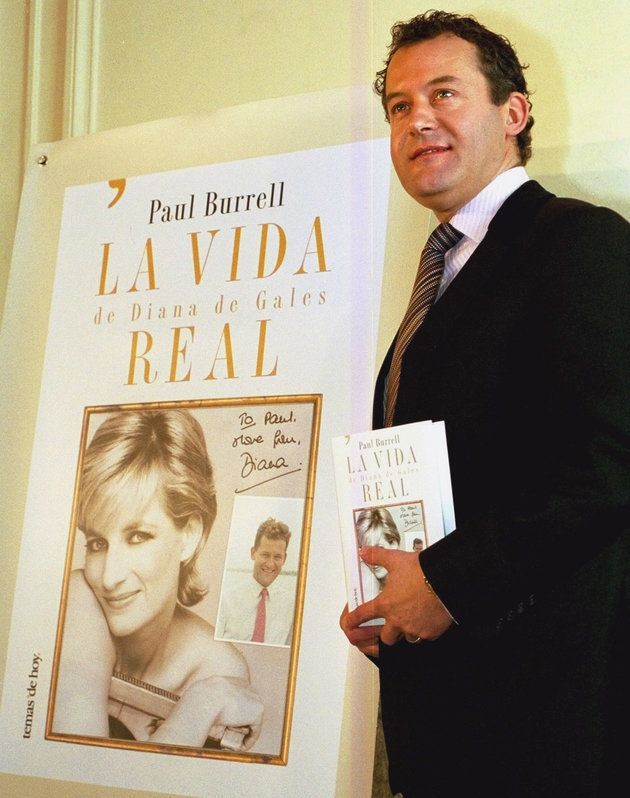 Burrell poses with a copy of the Spanish version of his book, 'A Royal Duty' in