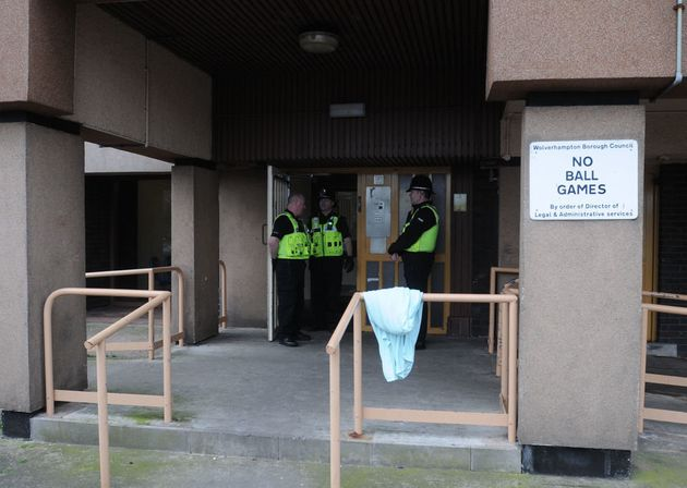 Police outside the block of flats after the