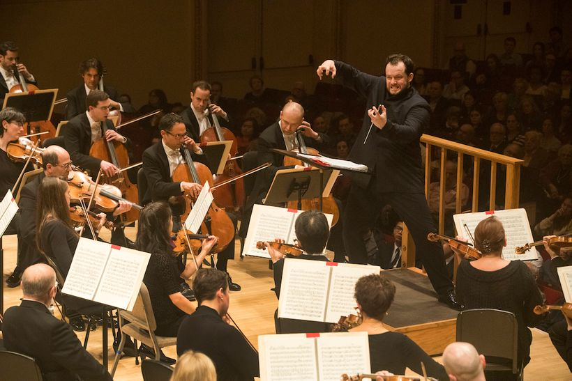 Andris Nelsons conducting the Boston Symphony Orchestra at Carnegie Hall.