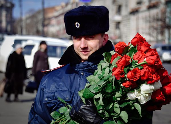 A traffic policeman gives flowers to female drivers ahead of International Women's Day on the city's Central Square.&nb