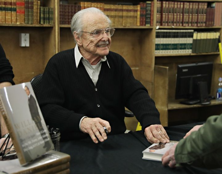 """Daniels signs copies of """"There I Go Again"""" in New York on March 2."""