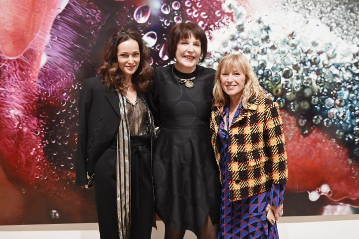 Marilyn Minter (center) and Cindy Sherman (right) in front of Minter's work.