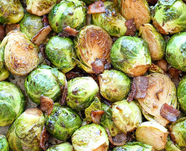 """<strong>Get the <a href=""""http://damndelicious.net/2014/11/10/roasted-garlic-brussels-sprouts/"""" target=""""_blank"""">Roasted Garlic"""