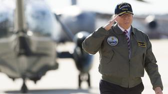US President Donald Trump salutes as he walks to Air Force One prior to departing from Langley Air Force Base in Virginia, March 2, 2017, as he traveled to Newport News, Virginia, to visit the pre-commissioned USS Gerald R. Ford aircraft carrier. / AFP PHOTO / SAUL LOEB        (Photo credit should read SAUL LOEB/AFP/Getty Images)