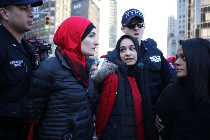 """Protesters getting arrested during """"A Day Without A Woman"""" strike outside of Trump International Hotel."""
