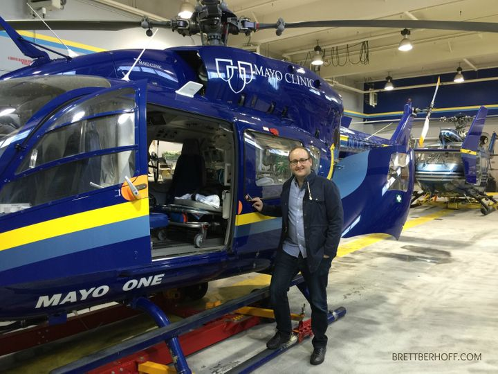 <p>Brett Berhoff checking out the Mayo Clinic Helicopter fleet</p>