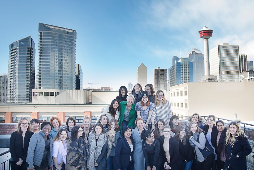 A handful of Benevity's women gather on the rooftop of the Pilkington Building in Calgary for International Women's Day (It w