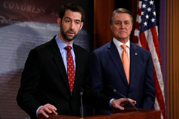 Sens. Tom Cotton (left) and David Perdue unveil their plan to slash legal immigration on Feb. 7,