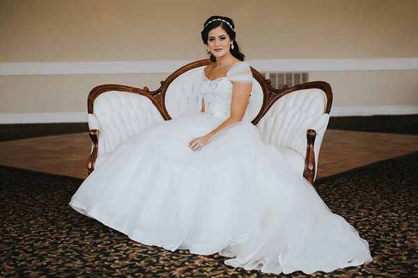 "A yellow gown isn't the only way to channel Belle; instead, mirror her romantic look with an off-the-shoulder ballgown.&nbsp;<i>Related: <a href=""http://bridalguide.com/dresses/find-the-perfect-dress/dress-trends/wedding-ball-gowns"" target=""_blank"" rel=""nofollow"">50+ Beautiful New Wedding Ball Gowns</a></i>"