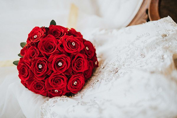 "Opt for a classic red rose bouquet. <i>Related: <a href=""http://www.bridalguide.com/planning/the-details/decor-flowers/unique-red-roses#169574"" target=""_blank"" rel=""nofollow"">15 Unique Ways to Use Red Roses in Your Wedding</a></i>"