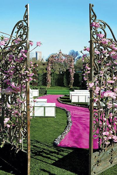 "Adorn the castle's gates with lush flowers. <i>Related: <a href=""http://bridalguide.com/planning/the-details/ceremony/ceremony-aisle-decorations"" target=""_blank"" rel=""nofollow"">40 Ways to Decorate Your Ceremony Aisle</a></i>"