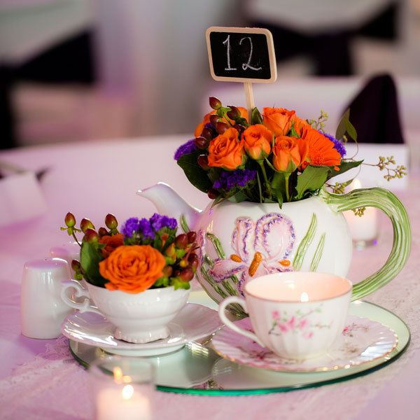 "A pretty tea set makes a perfectly charming centerpiece. <i>Related: <a href=""http://www.bridalguide.com/planning/the-details/theme/vintage-wedding-ideas"" target=""_blank"" rel=""nofollow"">50 Ideas for a Vintage-Inspired Wedding</a></i>"
