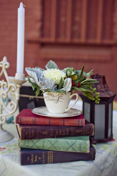 "A stack of books, topped with a teacup, is a simple and inexpensive centerpiece. <i>Related: <a href=""http://bridalguide.com/blogs/bridal-buzz/literary-theme-wedding"" target=""_blank"" rel=""nofollow"">10 Sweet Ideas for a Literary-Themed Wedding</a></i>"