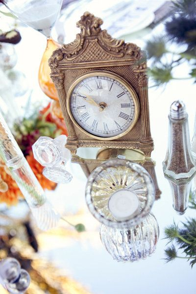 "Add a clock to your tablescape as a nod to Cogsworth. <i>Related: <a href=""http://www.bridalguide.com/planning/the-details/decor-flowers/wedding-decor-reception#157977"" target=""_blank"" rel=""nofollow"">50 Gorgeous Ways to Dress Up Your Reception Tables</a></i>"