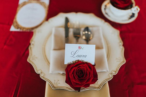 "Dress up each place setting with a single red rose. <i>Related: <a href=""http://www.bridalguide.com/planning/the-details/reception/escort-cards#157757"" target=""_blank"" rel=""nofollow"">35 Cool Ways to Display Your Escort Cards</a></i>"