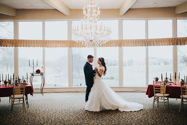 "Share a dance beneath a chandelier, just like in the castle's ballroom. <i>Related: <a href=""http://www.bridalguide.com/planning/the-details/photo-video/new-must-have-wedding-photos#140718"" target=""_blank"" rel=""nofollow"">75+ New Must-Have Photos With Your Groom</a></i>"