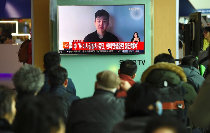 South Koreans watch a video on the news Wednesday that shows a man claiming to bethe son of Kim Jong Un's elder half-br