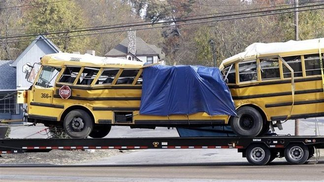 A school bus is carried away from a crash site in November in Chattanooga, Tennessee. Six elementary school students died and
